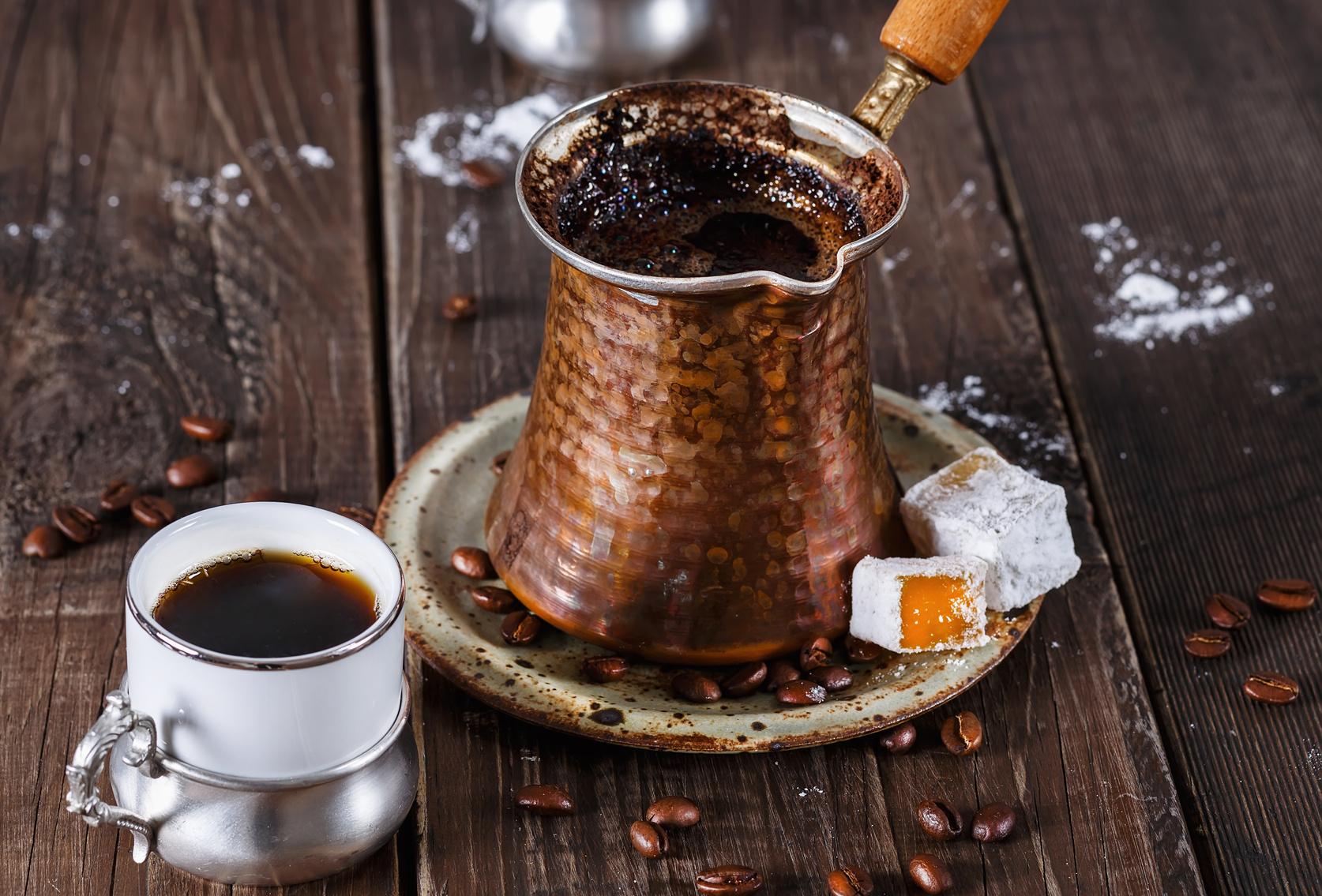 Турка с чашкой кофе
